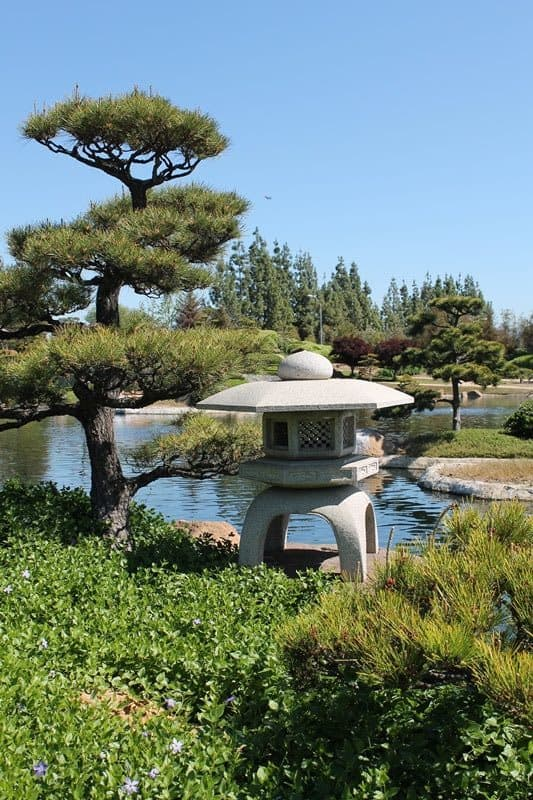 Stone lantern and lake in the garden.