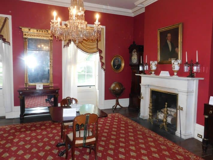 An elegant fireplace room inside the Ten Broeck Mansion. Many items and furniture within the mansion are originals.