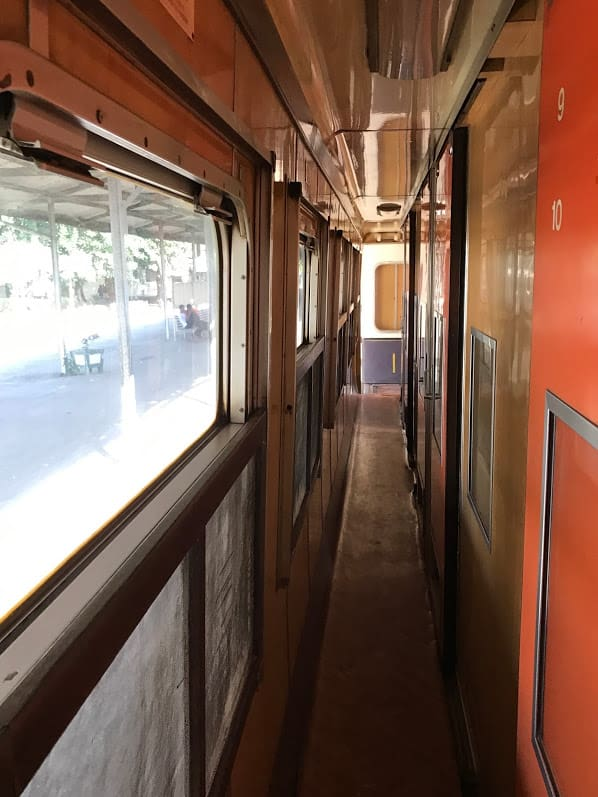 The old train's narrow corridors were barely wide enough for two people to pass each other.