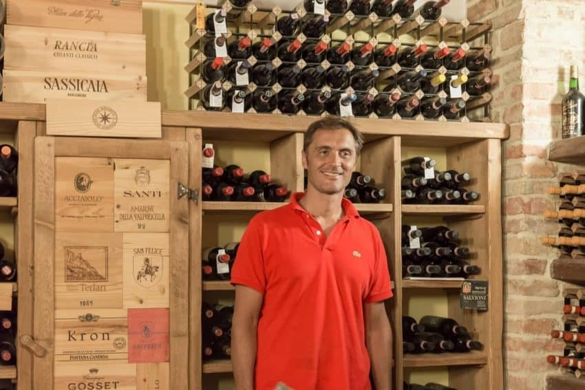 Giovanni shows off the Family wine cellar.
