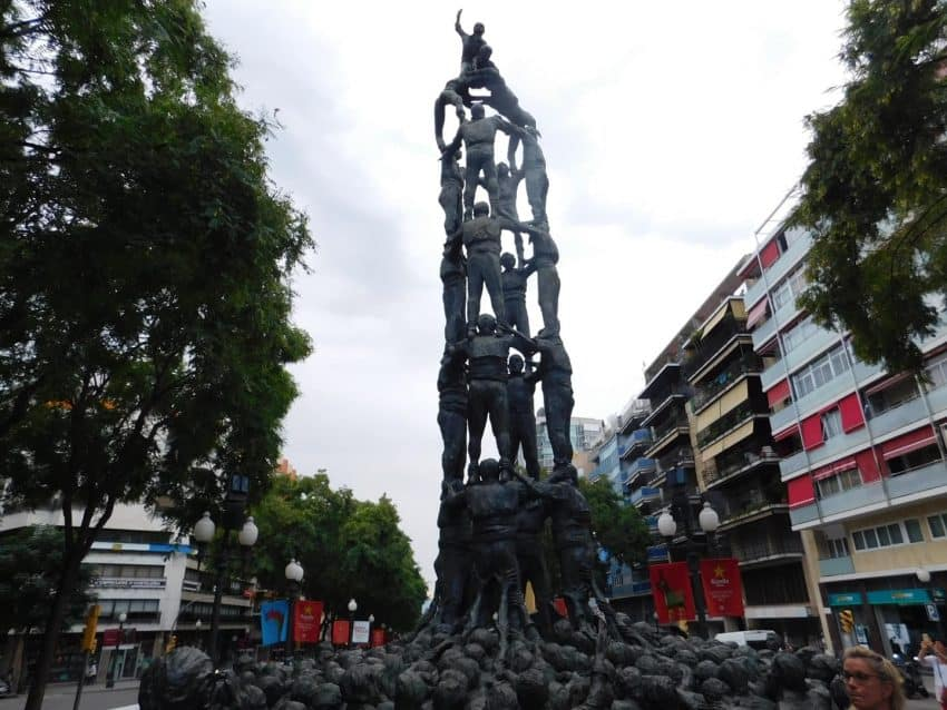 A statue that represents castellers building a human tower, located on La Rambla Nova.