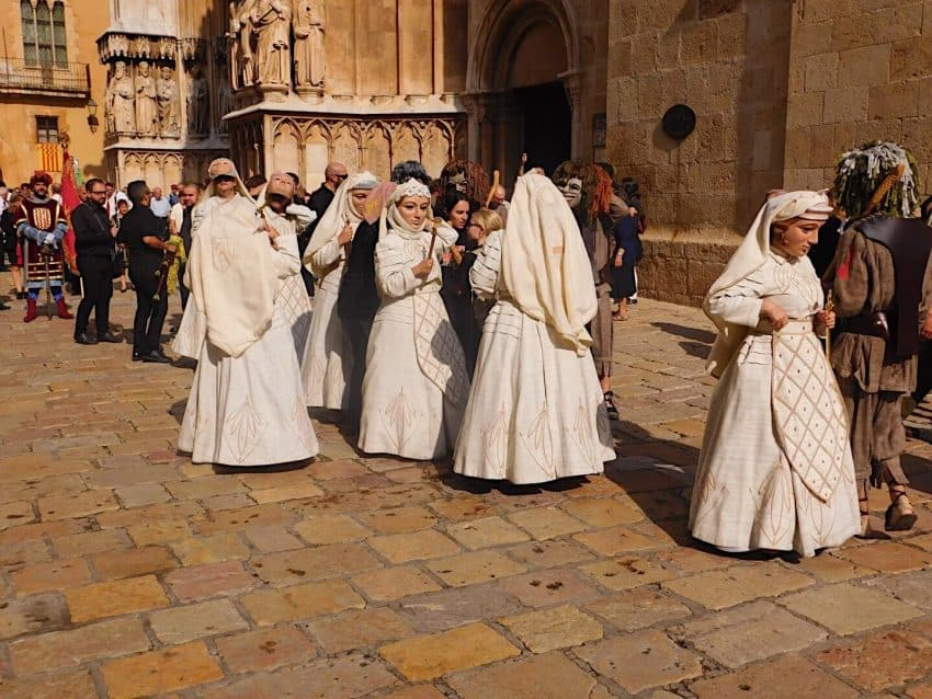 A traditional dance involving the Seven Cardinal Virtues takes places infront of the cathedral.
