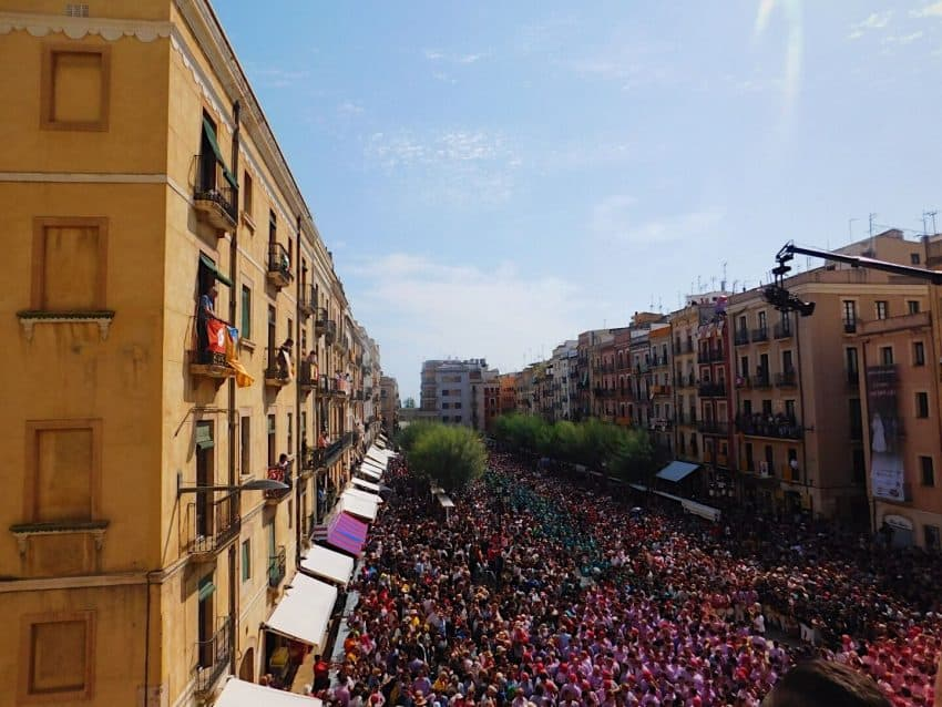 Hundreds of people gather in the city to watch the castellers compete in the human tower competition.