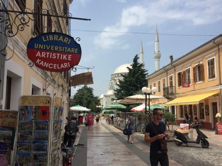 Kolë Idromeno Street, the main pedestrian drag, in Shkodër, with Ebu Bekr Mosque in the background.