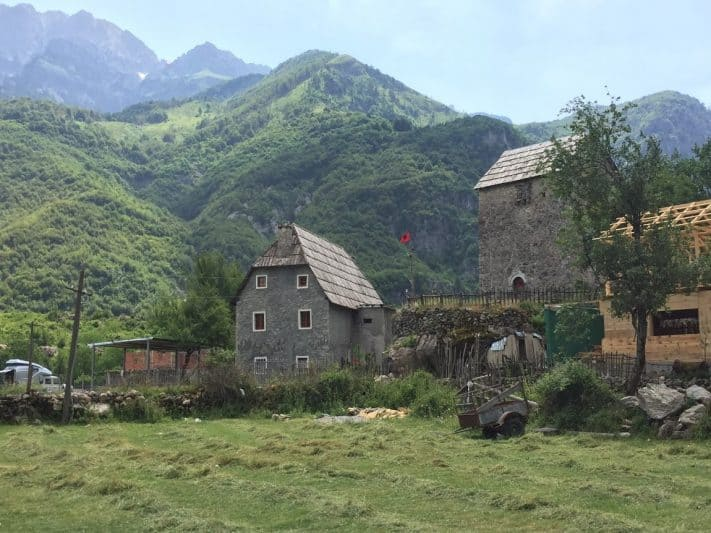 Old mills in the center of Theth, with the Albanian Alps in the background.