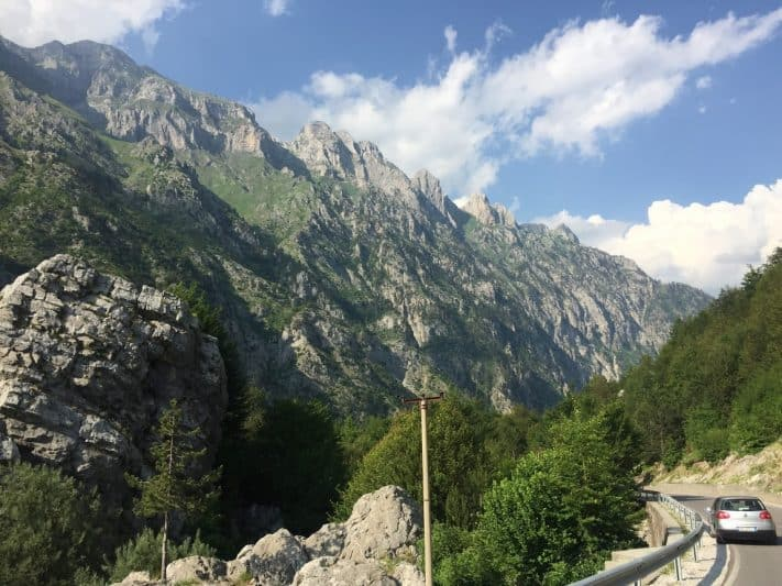 Sharp peaks line the road leading into Valbonë Valley in the Albanian Alps.