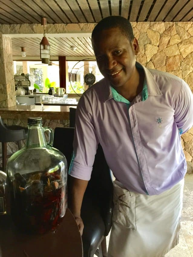 Dennis, one of the Rum Cave's rum connoisseurs, sampling fine rums at Marigot Bay Resort.