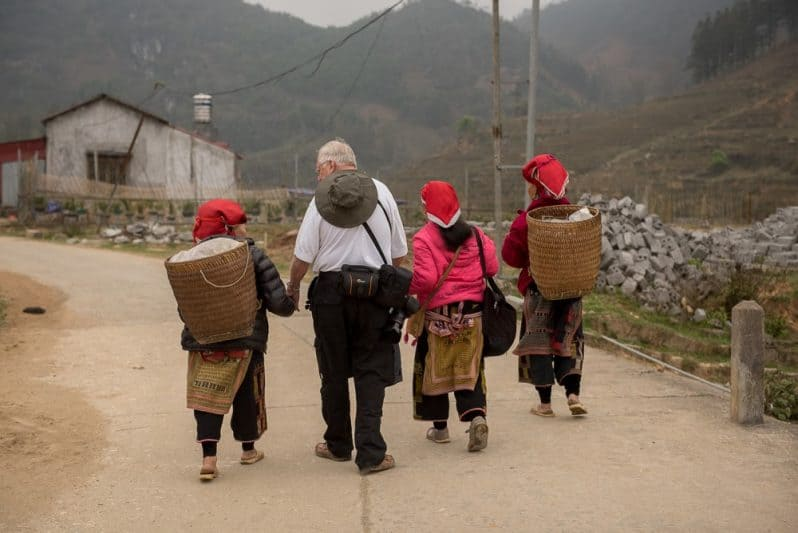 Eager to escort visitors through their Ta Phin village, the women will eventually pull out goods from the woven baskets in hopes of selling their handicrafts.