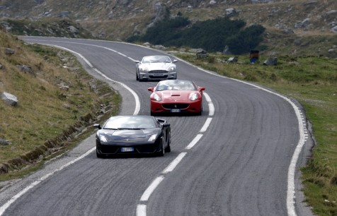 High performance sports cars take on the winding road. roadstodrive.com photo.