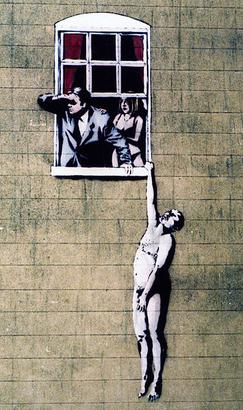 This original Banksy was partly vandalized by rival artists, but you can still see it on the side of a building downtown.