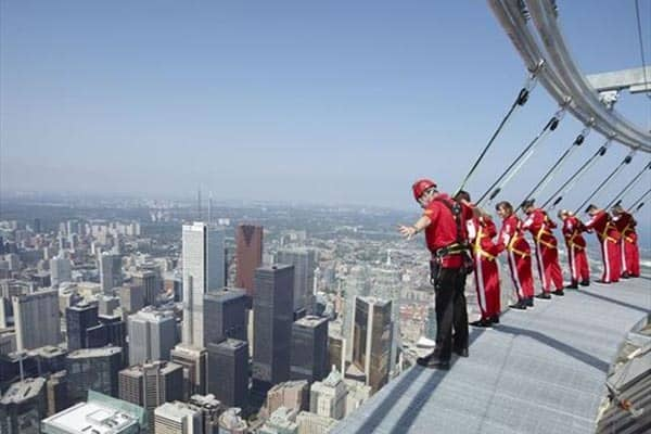 CN-Tower Toronto: if you are daring enough, you can hang off the edge like these guys are doing!
