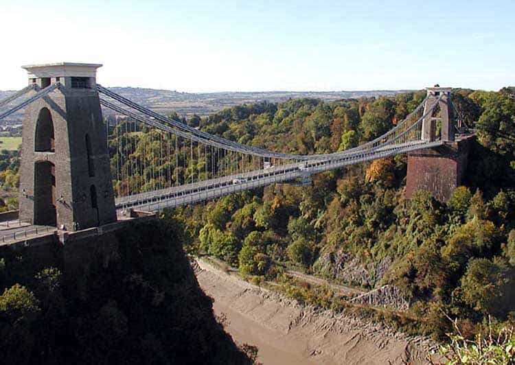 The Clifton Suspension Bridge is a symbol of Bristol, England, high above the Avon River.