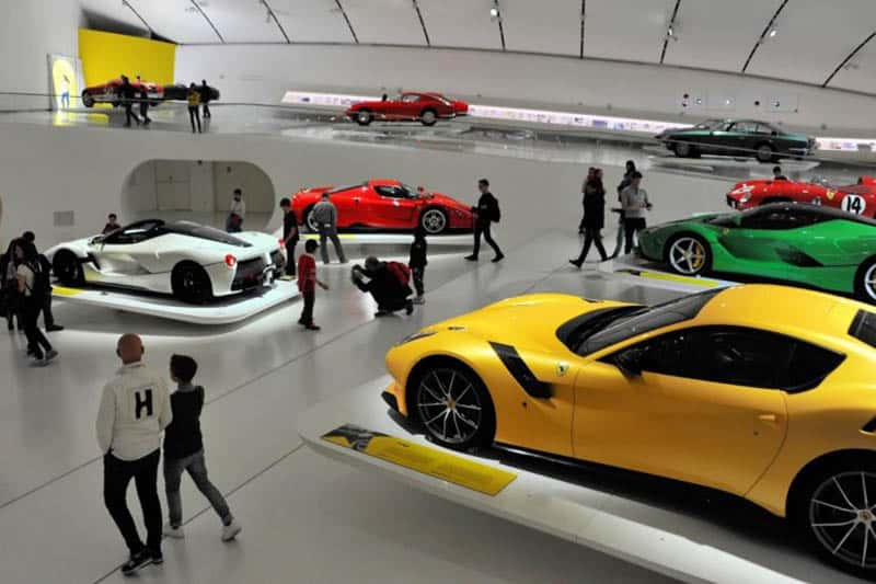 Visitors explore the many Ferraris and Ferrari models in the gift shop at The Ferrari Museum.
