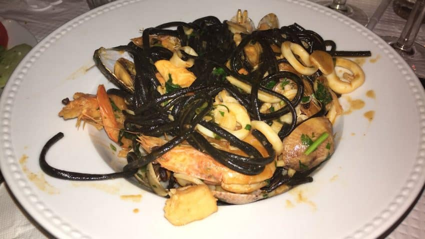 At the Mira Mar Restaurant in Salema, a divine squid-ink pasta with seafood.