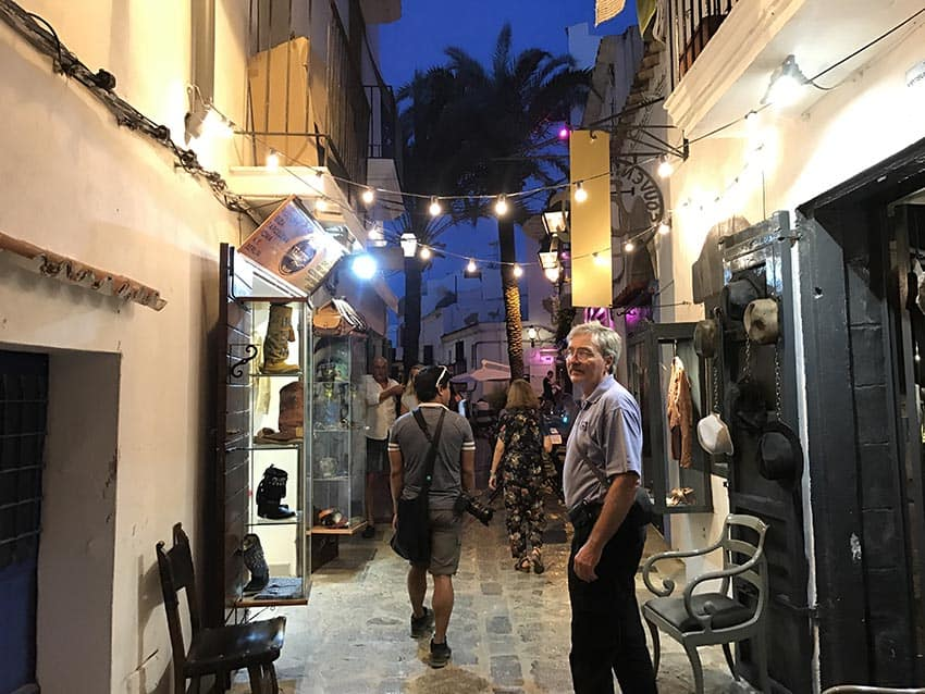 Walking through the cobblestone streets of Ibiza's old town. Locals and guests are just beginning their night out as the sun sets.