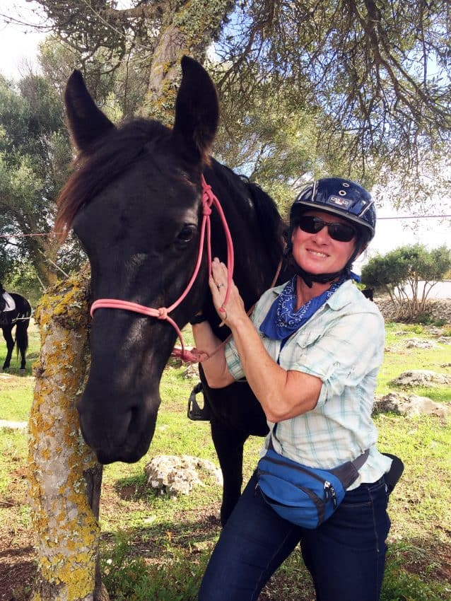 Melissa DeVaughn on the last day, with her mare, Xirola.