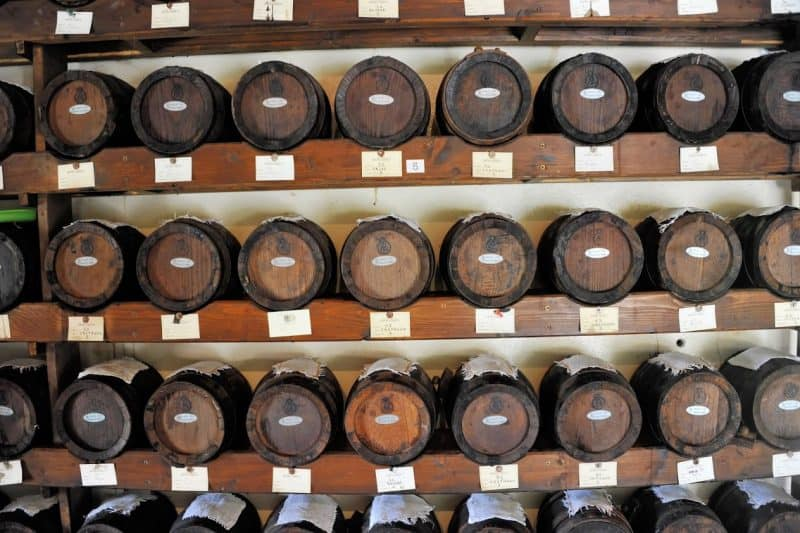 Small barrels of balsamic vinegar aging for clients and family.