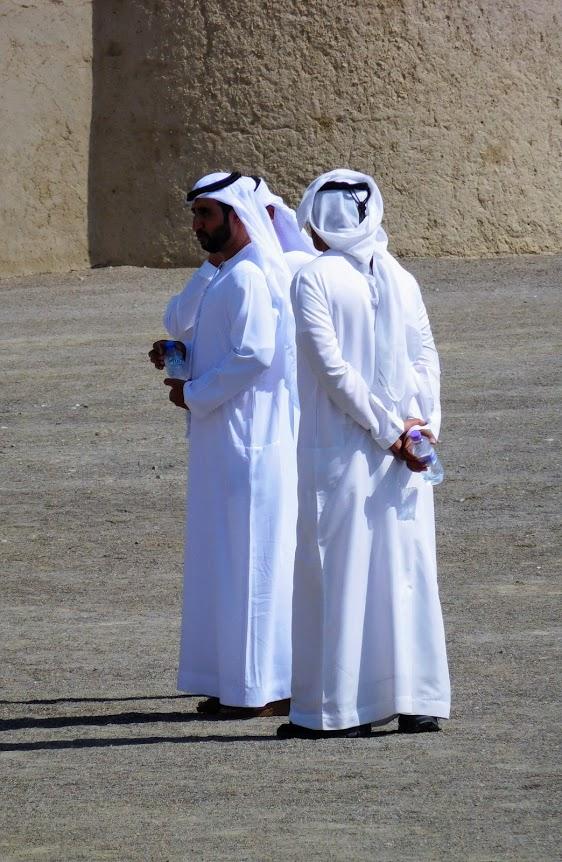 Men wearing dish-dashas in Abu Dhabi.
