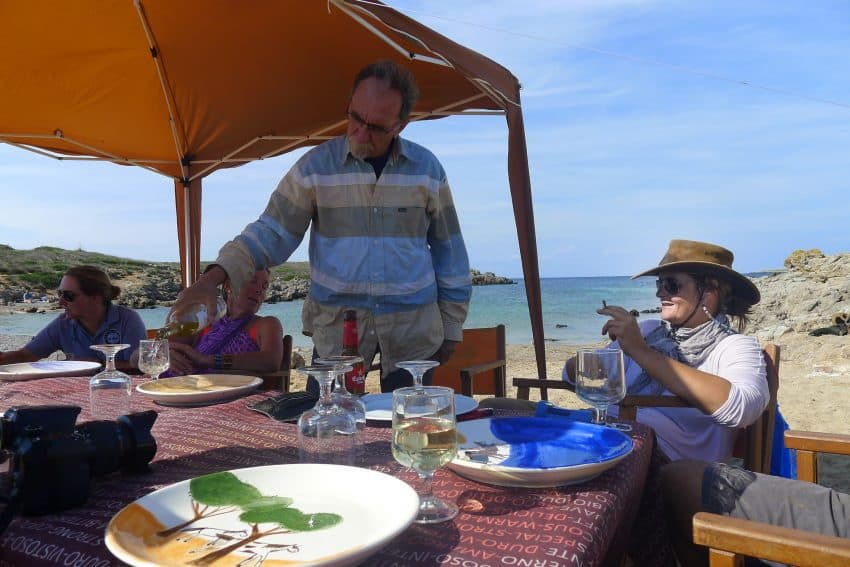 Yves Courrier from the Bordeaux, France, region, and Catalina Florit, our guide, relax by a beachside picnic site set up by the support crew.