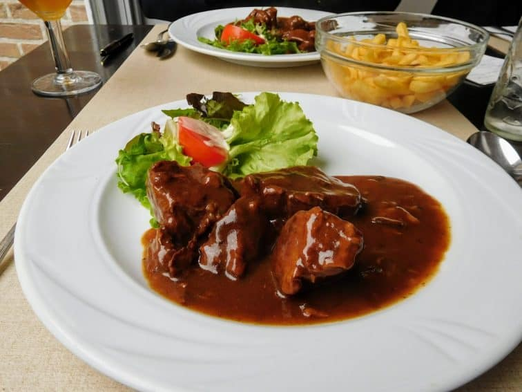 Flemish beef and beer stew, served with salad and frites
