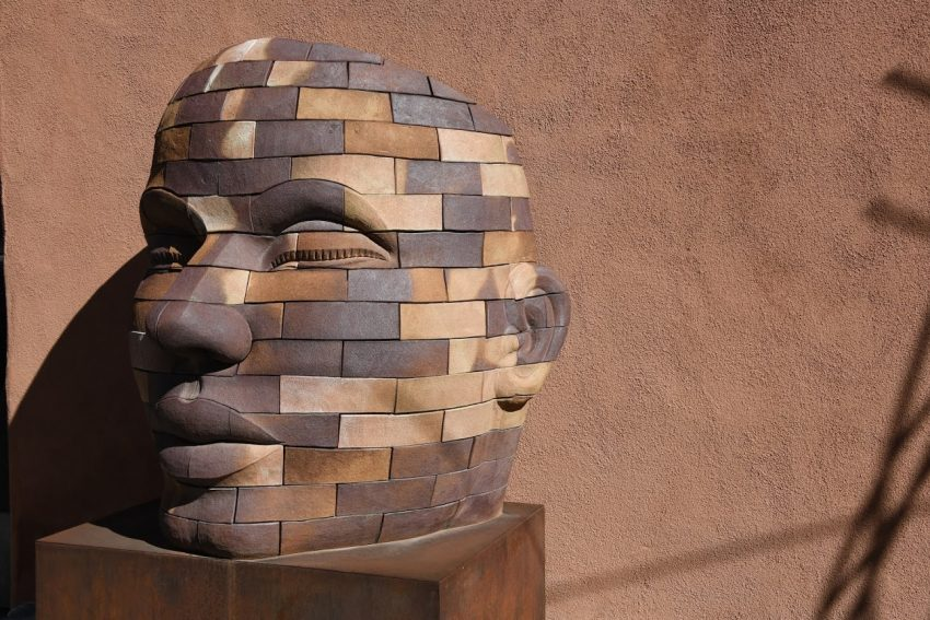 Large human face sculpture on Canyon Rd, Santa Fe.