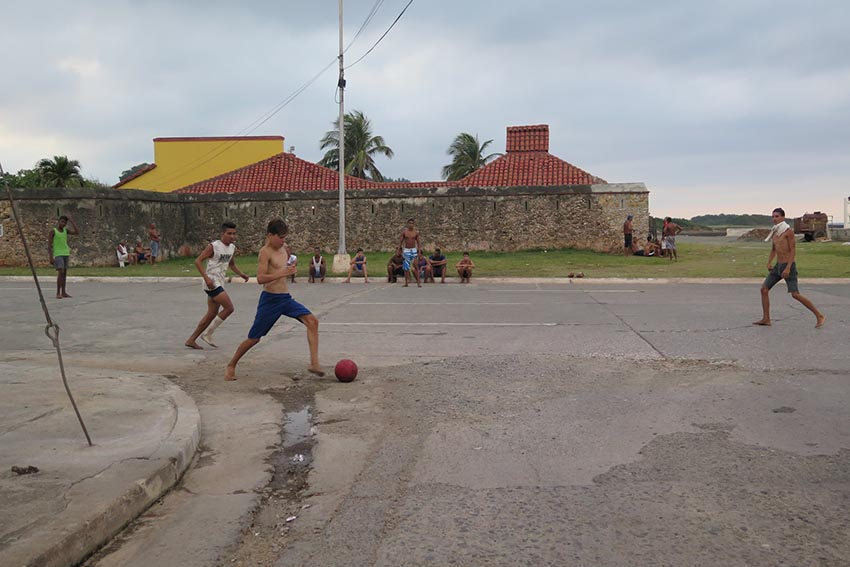 Soccer, played barefoot on the streets, is a common sight in Baracoa