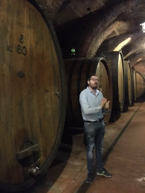 At a wine tasting in the town of Montepulciano,, we tour a cellar housed in caves carved by the Etruscans. Photo by Peter Petre.