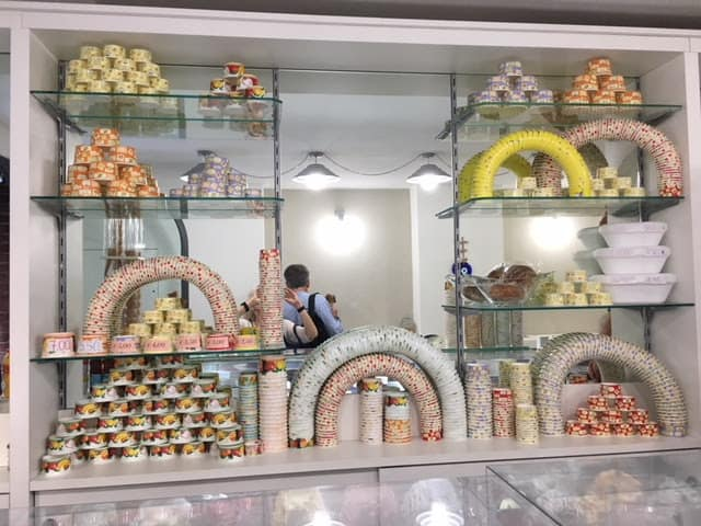 A fancy display of containers in a gelato place in Assisi -- not one of the ones approved by Marco. Photo by Ann Banks.