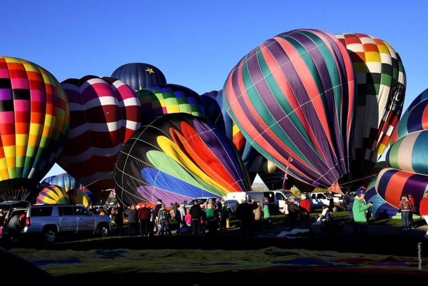 The morning is chaotic as so many balloons prepare to take off in the large fields.