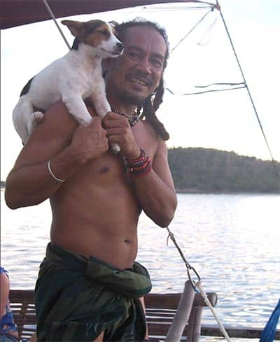 The captain of the boat with his Jack Russell terrier.