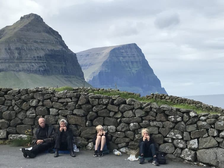 Picnic at the Church in Vidareidi, in the Faroe Islands between the west coast of Norway and the east coast of Iceland. Karel Amaranth photos.