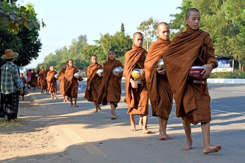 Monks collecting alms along the road in Myanmar.