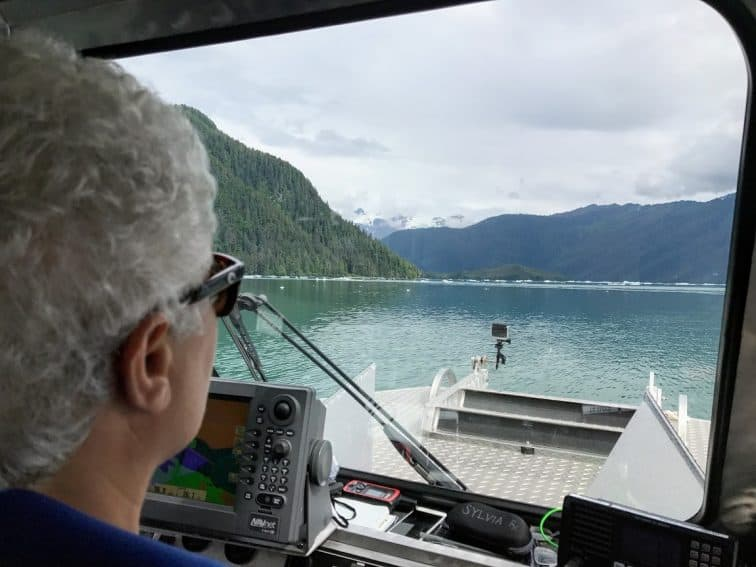 Sylvia Ettafagh, Fisheries Biologist and woner of Alaska Vistas, approaching icebergs in LeConte Bay.