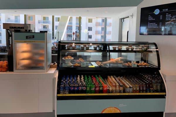 You can buy hot and cold food for the train journey on Brightline.