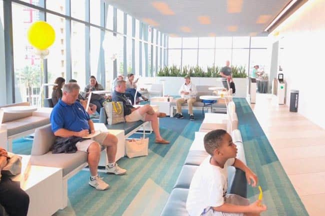 The spacious and airy Brightline lobby in Palm Beach, resembles a doctor's office more than a train station.