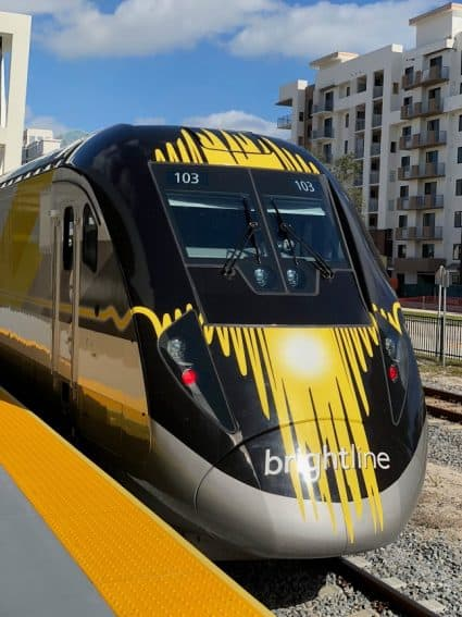 Locomotive 103 propels the sleek trainset Brightline is now operating in Florida.