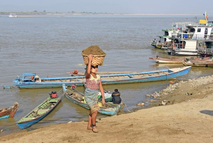 Hauling sand in Mandalay, using her head.