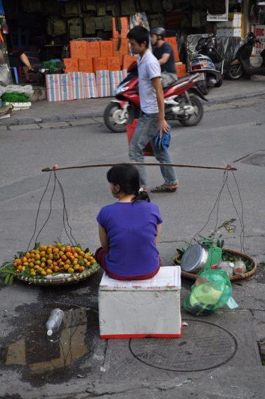 A roadside fruit seller in Hanoi.