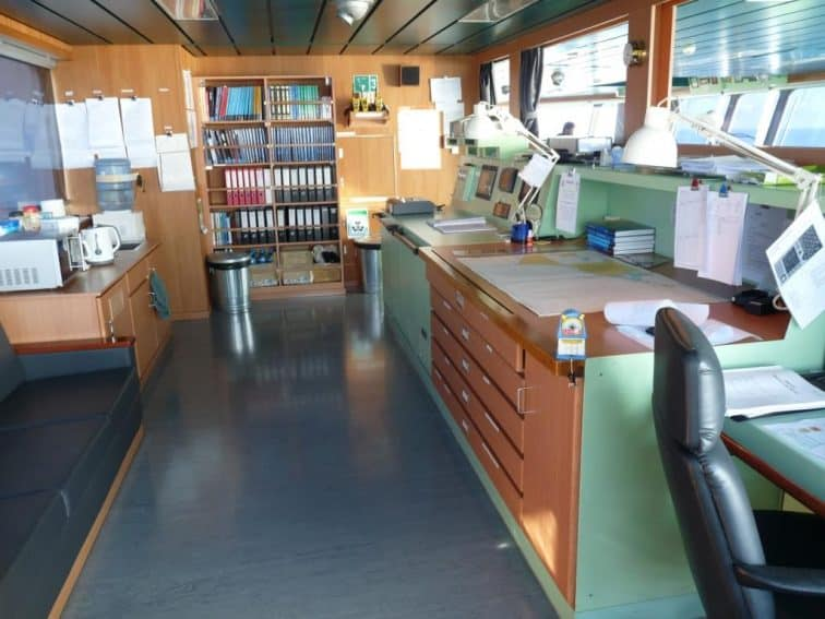 Inside the ship's Navigation room.