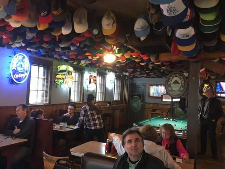 The Helvetia Tavern in Hillsboro, OR boasts an impressive collection of hats on the ceiling.