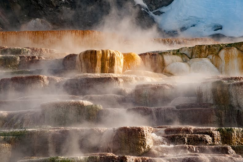 Mammoth Hot Springs serves as the park's headquarters and is home to a series of travertine terraces that are constantly changing in color and water flows.