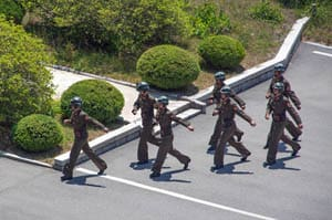 Soldiers march in formation in the demilitarized zone in North Korea.