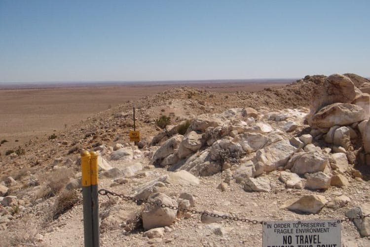 Visitors are not allowed to venture too far at the Meteor Crater site in order to preserve the landscape.