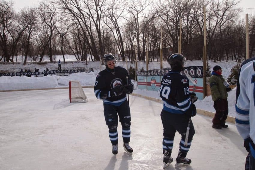 Members of the Winnipeg Jets at a practice game held on the river.