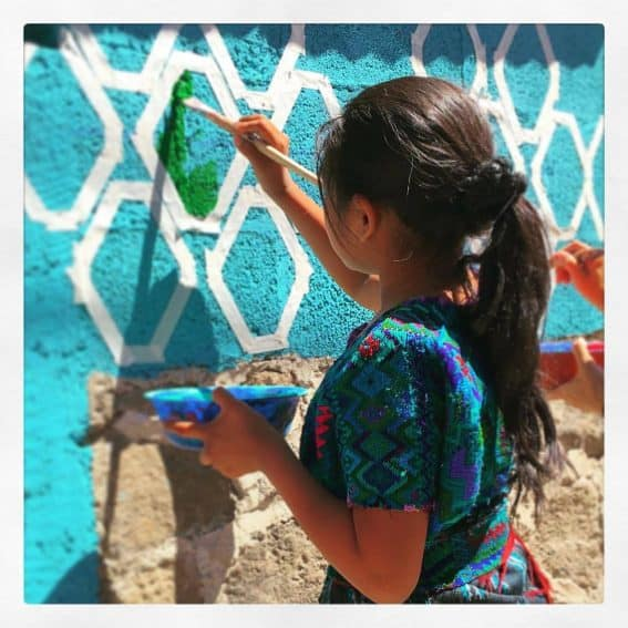 Painting a home with the Pintando Santa Catarina project.