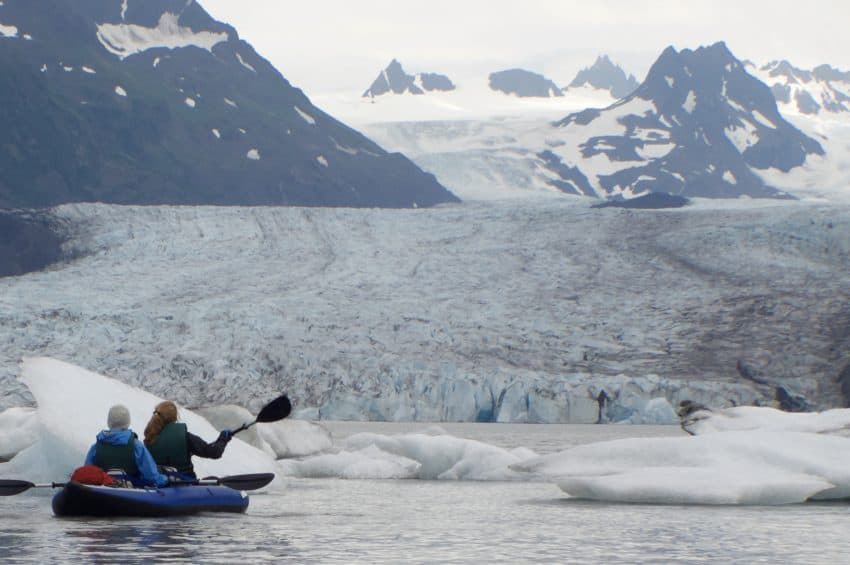 Kayakers nearing Grewingk Glacier Alaska's Ridgewood Wilderness Lodge: Gateway to Adventure