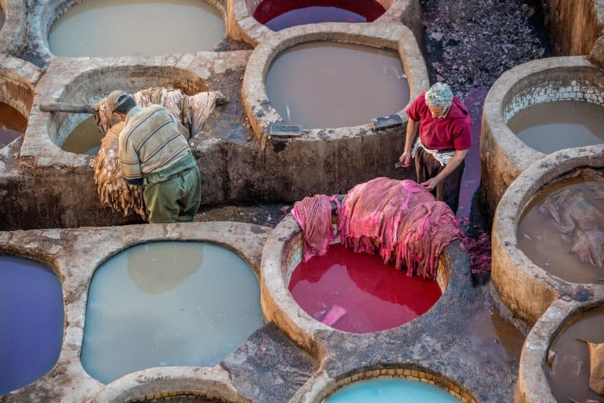 Fez is well known for its tanneries. The hides of cows, sheep, goats, and camels are dyed before being turned into all sorts of leather goods, including shoes, purses, wallets, jackets, and backpacks. With the help of a guide, its possible to get up above the tanneries and out on a porch to watch the dying process.