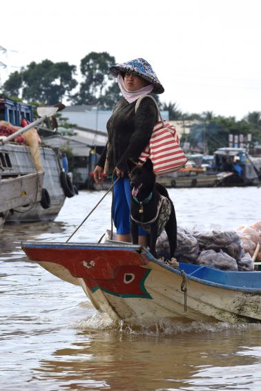 Lady with dog in the Floating Market.