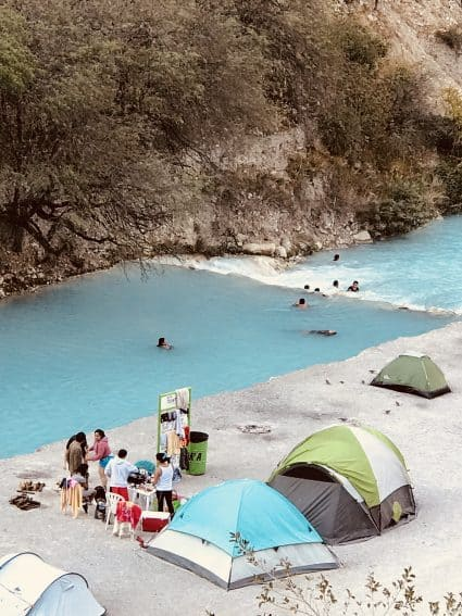 Locals camping and cooking fragrant food next to the thermal river in Tolantongo, Mexico. Karolee Bulak photos. | GoNOMAD Travel
