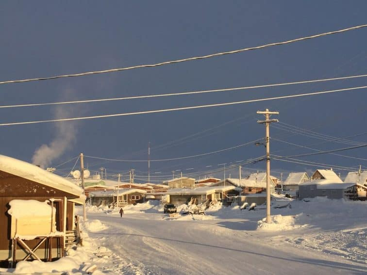 Walking through the Qikiqtarjuaq community in Nunavut. Photo from Max Johnson. | GoNOMAD Travel